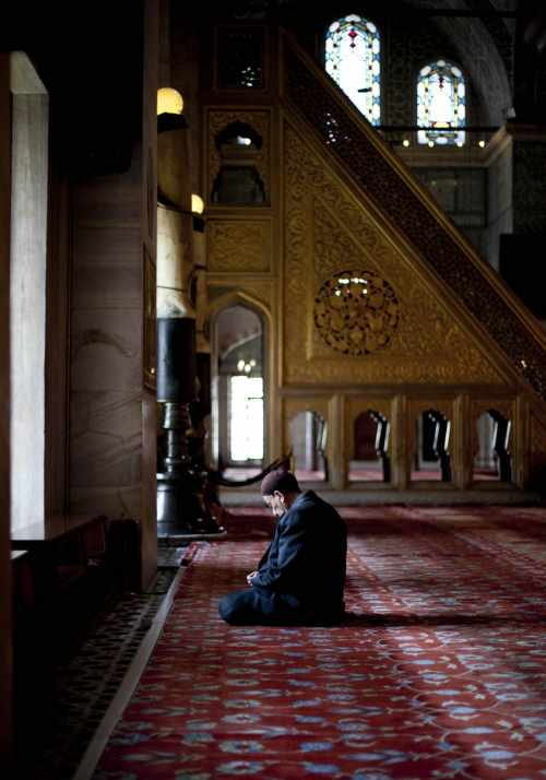 A Man Sits And Prays By A Window During President Michael D Higgins And His Wife Sabina'S Visit To The Blue Mosque In Istanbul